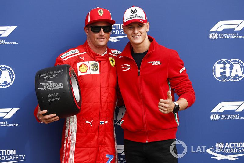 Polesitter Kimi Raikkonen, Ferrari, with Mick Schumacher