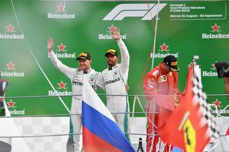 Valtteri Bottas, Mercedes AMG F1 and Lewis Hamilton, Mercedes AMG F1 celebrate on the podium and Kimi Raikkonen, Ferrari with Ferrari flag