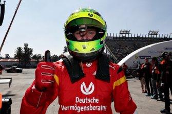 Mick Schumacher celebrates winning in the qualifying round