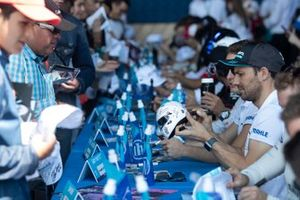 Gary Paffett, HWA Racelab signs a miniature helmet at the autograph session