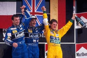 Podium: second place Riccardo Patrese, Williams, Race winner Nigel Mansell, Williams, third place Michael Schumacher, Benetton