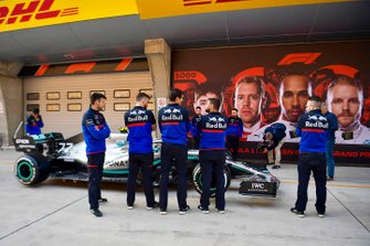 Toro Rosso mechanics examine a Mercedes AMG F1 W10