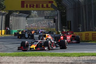 Max Verstappen, Red Bull Racing RB15, leads Charles Leclerc, Ferrari SF90, and Kevin Magnussen, Haas F1 Team VF-19