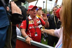A member of the media speaks to a fan