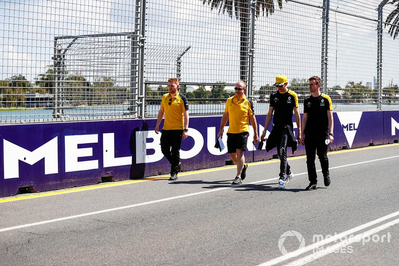 Esteban Ocon, Renault F1 and members of the team walk the track