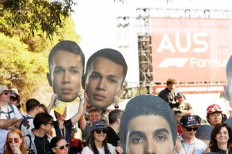 Fans with cardboard cutouts in support of Alex Albon, Red Bull Racing.