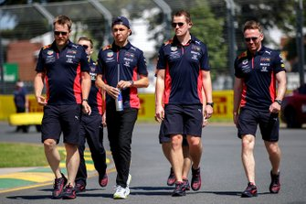 Alex Albon, Red Bull Racing and members of the team walk the track
