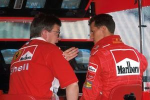 Race Winner Michael Schumacher, Ferrari F300 chats with Ferrari's Technical Director Ross Brawn