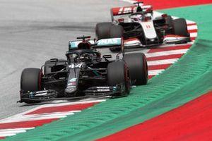 Lewis Hamilton, Mercedes F1 W11 EQ Performance, leads Romain Grosjean, Haas VF-20