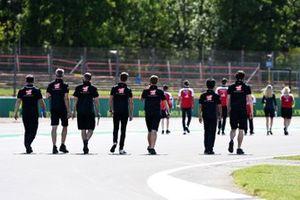 Romain Grosjean, Haas F1 walks the track with members of the team