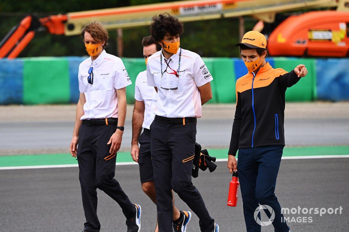 Lando Norris, McLaren, walks the track with colleagues