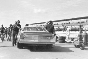 Richard Petty's crew chief and cousin, Dale Inman talks with Maurice Petty, Richard's engine builder and brother