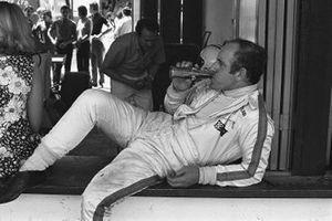 Denny Hulme, McLaren drinks a Coca-Cola