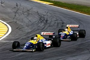 Riccardo Patrese, Williams FW14B Renault, leads Nigel Mansell, Williams FW14B Renault