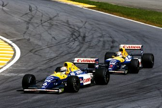 Riccardo Patrese, Williams FW14B Renault, leads Nigel Mansell, Williams FW14B Renault