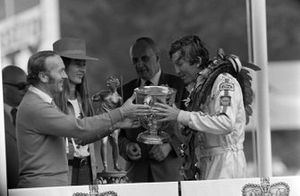 Race winner Jochen Rindt receives his trophy on the podium from Colin Chapman