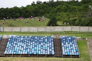 Some fans find a vantage point outside the circuit