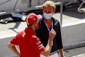 Sebastian Vettel, Ferrari, talks with Nico Rosberg