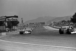 Emerson Fittipaldi, McLaren M23, Tony Brise, Hill GH1