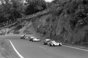 Andrea de Adamich, Surtees TS9B Ford leads Wilson Fittipaldi, Brabham BT34 Ford and Carlos Pace, March 711 Ford
