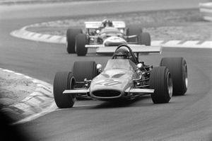 Andrea de Adamich, McLaren M14D Alfa Romeo leads Graham Hill, Lotus 49C Ford