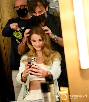A model has her hair done ready for her catwalk appearance in the Amber Lounge