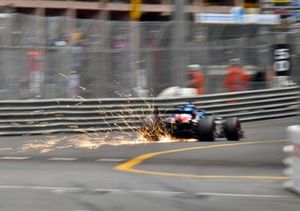 Sparks fly from the car of Fernando Alonso, Alpine A521