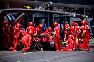 Carlos Sainz Jr., Ferrari SF21, in the pits during FP3