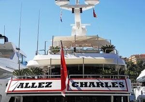 A yacht in the harbour displays support for Charles Leclerc, Ferrari