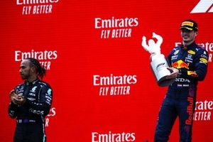 Lewis Hamilton, Mercedes, 2nd position, and Max Verstappen, Red Bull Racing, 1st position, with his trophy
