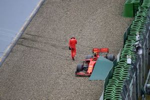 Charles Leclerc, Ferrari, climbs out of his car after crashing out