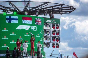 Lewis Hamilton, Mercedes AMG F1, 3rd position, Charles Leclerc, Ferrari, 1st position, and Valtteri Bottas, Mercedes AMG F1, 2nd position, on the podium