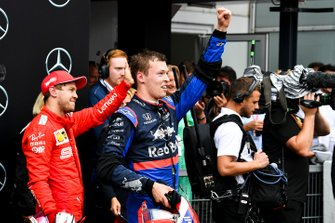 Sebastian Vettel, Ferrari, 2nd position, and Daniil Kvyat, Toro Rosso, 3rd position, celebrate in Parc Ferme