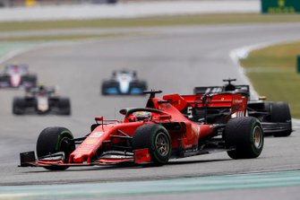 Sebastian Vettel, Ferrari SF90, leads Romain Grosjean, Haas F1 Team VF-19