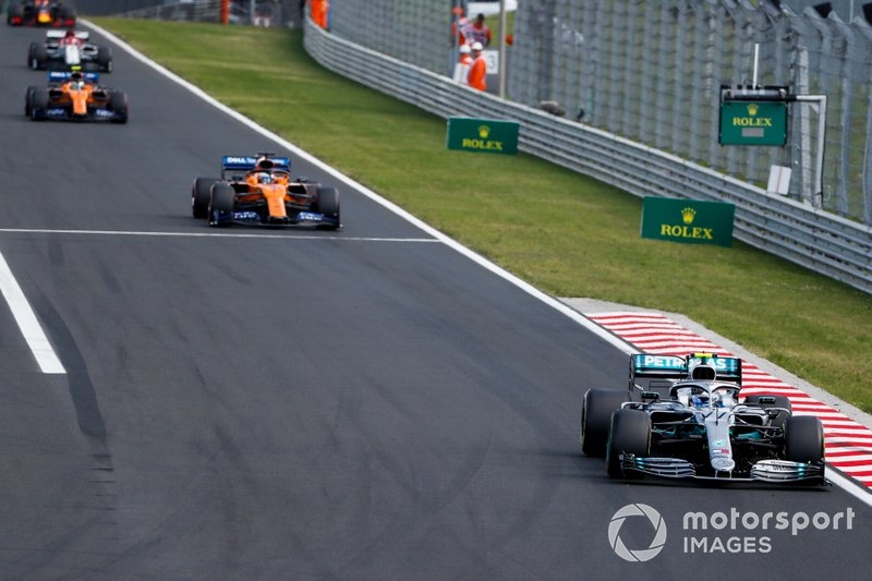 Valtteri Bottas, Mercedes AMG W10, leads Carlos Sainz Jr., McLaren MCL34, and Lando Norris, McLaren MCL34