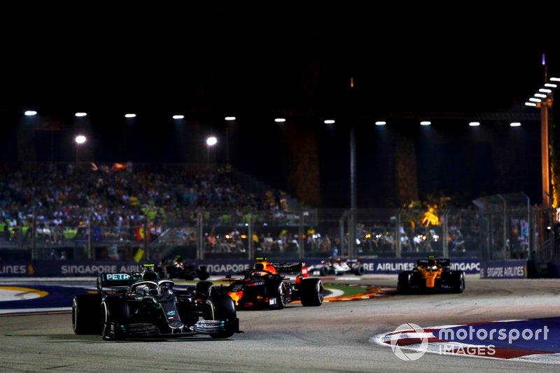 Valtteri Bottas, Mercedes AMG W10, leads Alexander Albon, Red Bull Racing RB15, and Lando Norris, McLaren MCL34