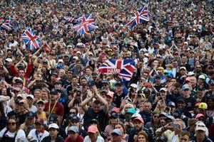 Fans watch Lewis Hamilton, Mercedes AMG F1, on stage