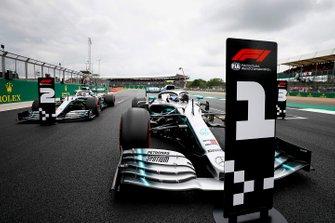 Pole Sitter Valtteri Bottas, Mercedes AMG W10 and Lewis Hamilton, Mercedes AMG F1 W10 drive into Parc Ferme