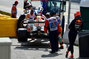 Max Verstappen, Red Bull Racing, looks on as marshals remove his car from the circuit