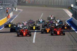 Sebastian Vettel, Ferrari SF90, leads Charles Leclerc, Ferrari SF90, Lewis Hamilton, Mercedes AMG F1 W10, Carlos Sainz Jr., McLaren MCL34, Valtteri Bottas, Mercedes AMG W10, and the rest of the field at the start of the race