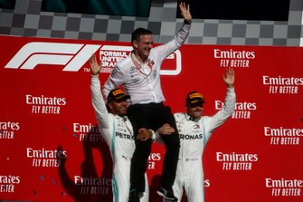 Lewis Hamilton, Mercedes AMG F1, 2nd position, and Valtteri Bottas, Mercedes AMG F1, 1st position, hoist James Allison, Technical Director, Mercedes AMG, onto their shoulders on the podium