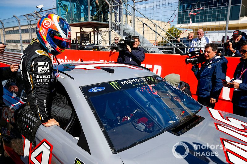 Kevin Magnussen, Haas F1 Team Team, rides in a NASCAR with Tony Stewart