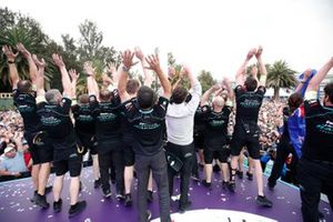 The Panasonic Jaguar Racing team celebrate on the podium
