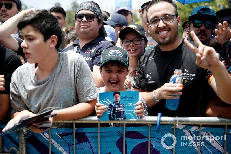 A fan holds a signed Mitch Evans, Jaguar Racing postcard