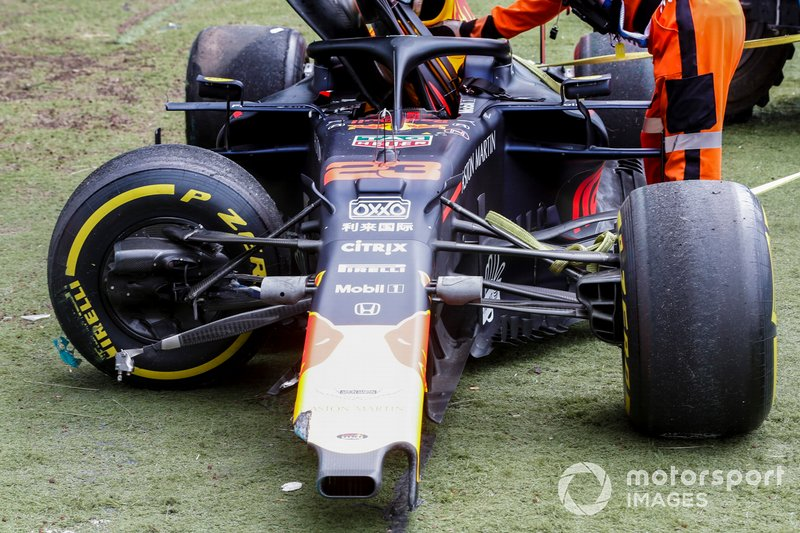 Car of Alex Albon, Red Bull RB15 with Marshals after being crashed in FP2