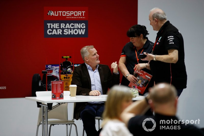 Johnny Herbert signs autographs for fans at the Autosport show