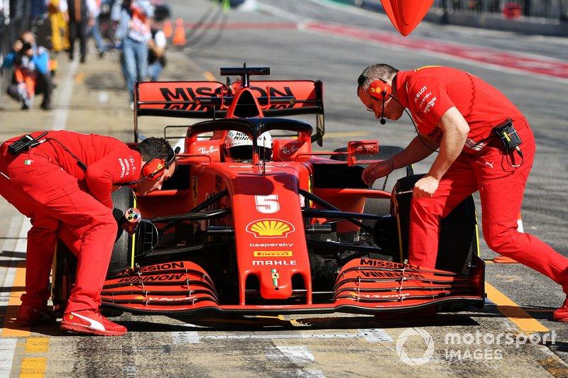 Sebastian Vettel, Ferrari, stops in his pit