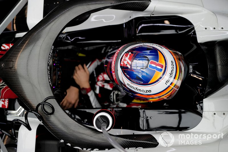 Romain Grosjean, Haas VF-20 sits in his car in the garage