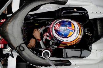 Romain Grosjean, Haas VF-20 sits in his car in the garage