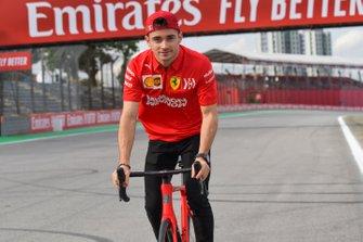 Charles Leclerc, Ferrari walks the track on a bike